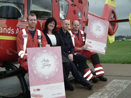 Crew of the Midlands Air Ambulance Charity pictured with Anita Williams